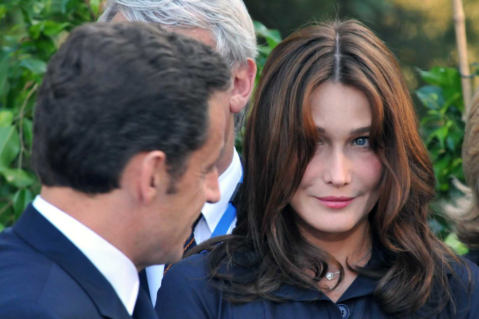French President Nicolas Sarkozy Looks At His Wife First Lady Carla Bruni During A