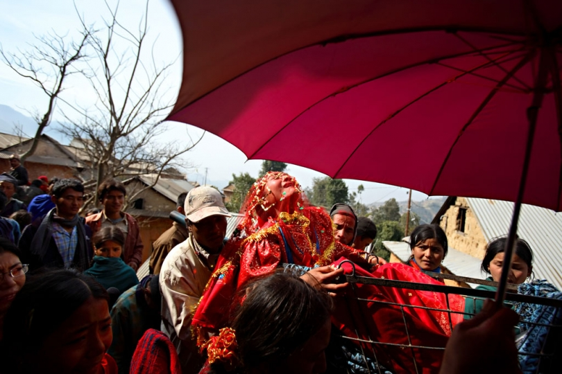 Surita Shreshta Balami, 16, screams out in protest as the wedding procession carries her to her new home with Bishal Shreshta Balami, 15 Kagati Village, Kathmandu Valley, Nepal on Jan. 29, 2007. Early marriage is a harmful traditional practice common in Nepal. The Kagati village, a Newar community, is most well known for its propensity towards this practice. Many Hindu families believe blessings will come upon them if marry off their girls before their first menstruation. © Stephanie Sinclair / VIIrn