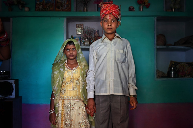 Maya, 8, and Kishore, 13, pose for a wedding photo inside their new home the day after the Hindu holy day of Akshaya Tritiya, or Akha Teej, in Rajasthan, India on April 29, 2009. © Stephanie Sinclair / VIIrn