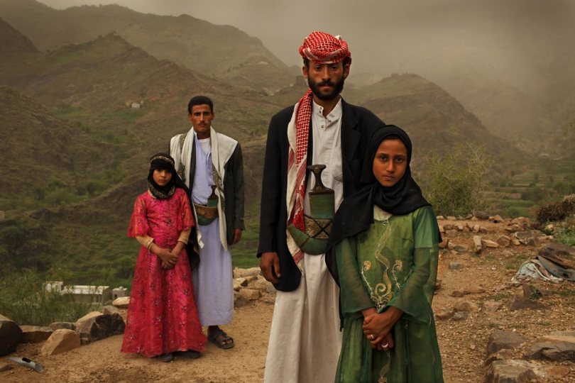 Tahani, 8, is seen with her husband Majed, 27, and her former classmate Ghada, 8, and her husband outside their home in Hajjah, Yemen, July 26, 2010. © Stephanie Sinclair / VIIrn