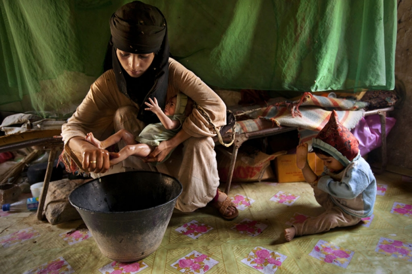 Asia Ali Al Abuss, 14, rests just days after giving birth to her second child in Hajjah, Yemen, July 30, 2010. © Stephanie Sinclair / VIIrn