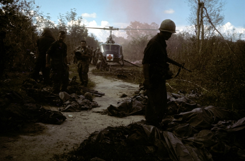 A medevac chopper evacuates casualties from the site of an ambush of the 173rd Airborne in the Iron Triangle, north west of Saigon.  September 1965. (From the book 'War') ©u00a0Tim Page