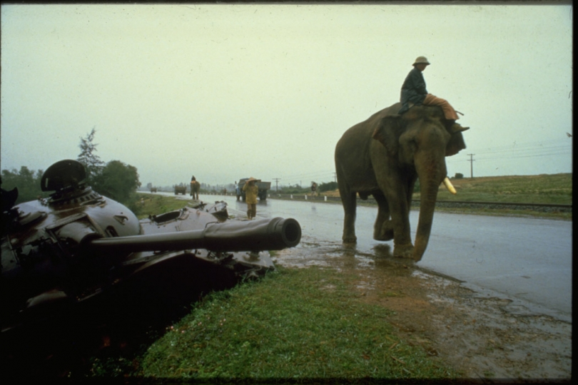 The Street Without Joy'.  The detritus of the 1972 Easter offensive still litters the roadside as two elephants plod past en route to Ha Noi.  1985 (From the book 'Ten Years After') © Tim Page