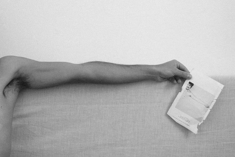 Page 56,57: self-portrait with Robert Mapplethorpeu2019s self-portrait (1975): a stretched arm holding a torn page taken from Camera Lucida - Roland Barthes, 2013 © Alaa Abu Asad