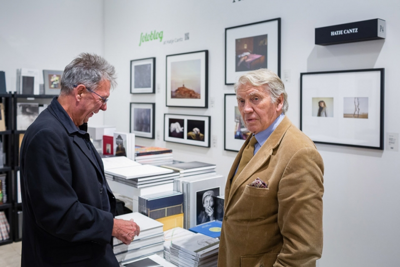 Celebrated photojournalist Don McCullin (right) looking at books before his talk with Francis Hudson © Magnus Arrevad