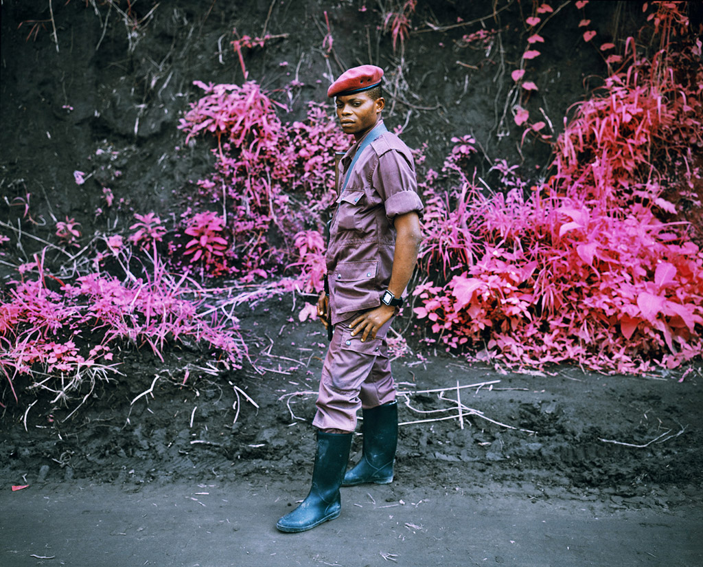 Kodak Aerochrome analogue infrared photo taken in North Kivu, Eastern Congo, in Feb 2010, showing FDLR rebel on day of integration into the Congolese National Army, FARDC.  © Richard Moose
