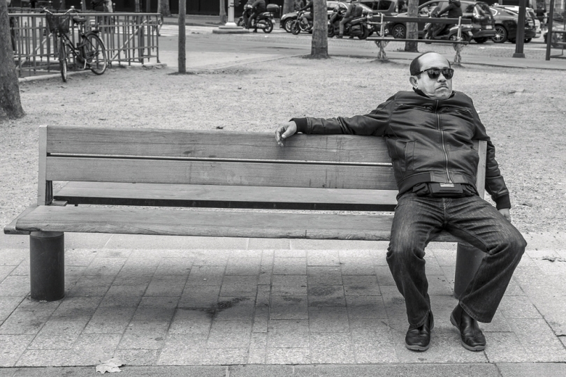 a tired Man sit on a bench Champs Elysées Paris by Roubinoff 2014