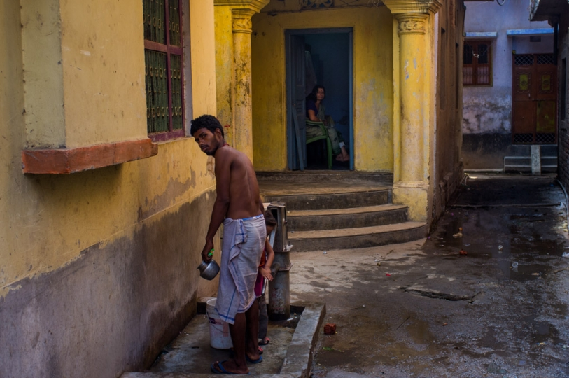 Neighbours staring at us, as we leave from the house for 'Pind Daan' rituals. Gaya. Bihar, India. 2015.