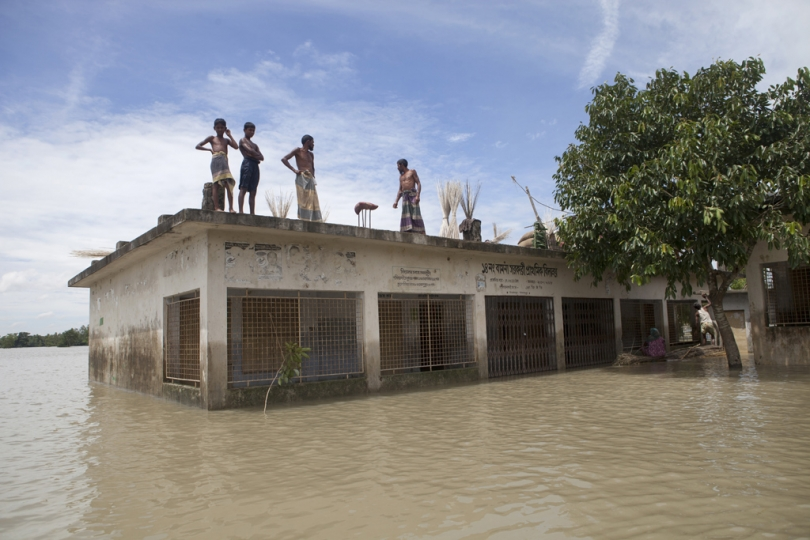 Flood affected people take shelter on a rooftop of a school building in Jamalpur. According to the Bangladesh Disaster Management Bureau around 1.5 million people have been affected by this year flood. Rivers in the north started to rise in early July and by the 20th of July nearly all of them started to flow over the danger level. It caused floods in 6 districts, namely, Lalmonirhat, Kurigram, Gaibandha, Jamalpur, Sirajganj and Sunamganj initially and inundated crop fields and dwelling areas, washed away standing crops, houses and household's assets, livestock and displaced the affected people.Bangladesh is one of the most climate change-vulnerable and disaster-prone countries. The rivers of this country are facing tremendous environmental anomalies. They overflow during the rainy season but shrink in other seasons. Floods in our country are directly or indirectly related to sub-Himalayan countries like India, Bhutan, and Nepal. An understanding should be made to protect the eco-system in the regions to minimize the risks of flash floods, and to share the water resources as per international laws.