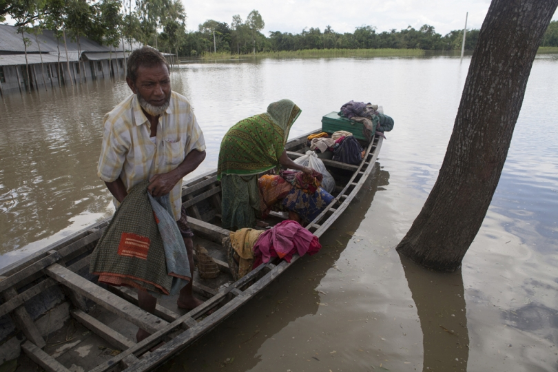 A flood affected family trying to move their belongings in a safe place in Islampur, Jamalpur. According to the Bangladesh Disaster Management Bureau around 1.5 million people have been affected by this year flood. Rivers in the north started to rise in early July and by the 20th of July nearly all of them started to flow over the danger level. It caused floods in 6 districts, namely, Lalmonirhat, Kurigram, Gaibandha, Jamalpur, Sirajganj and Sunamganj initially and inundated crop fields and dwelling areas, washed away standing crops, houses and household's assets, livestock and displaced the affected people.Bangladesh is one of the most climate change-vulnerable and disaster-prone countries. The rivers of this country are facing tremendous environmental anomalies. They overflow during the rainy season but shrink in other seasons. Floods in our country are directly or indirectly related to sub-Himalayan countries like India, Bhutan, and Nepal. An understanding should be made to protect the eco-system in the regions to minimize the risks of flash floods, and to share the water resources as per international laws.