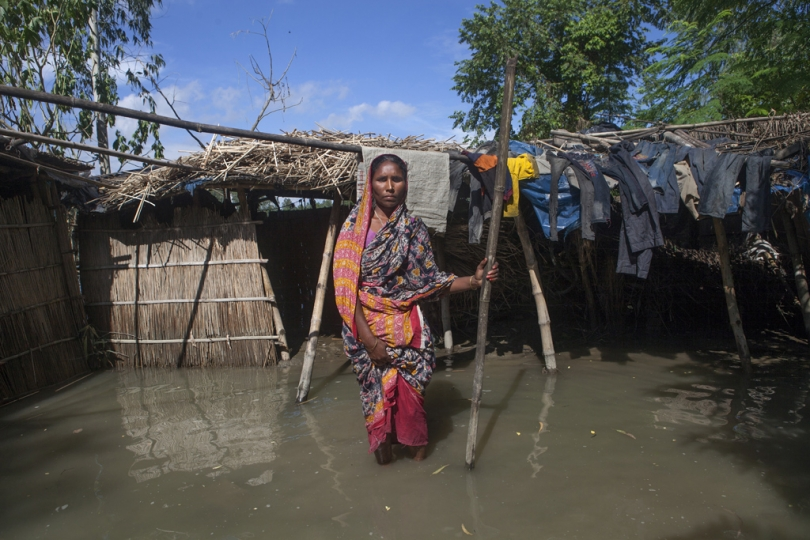 CHAMILY(35) is a flood victim, stands in the plunged yard of her home in Sarishabari, Jamalpur. According to the Bangladesh Disaster Management Bureau around 1.5 million people have been affected by this year flood. Rivers in the north started to rise in early July and by the 20th of July nearly all of them started to flow over the danger level. It caused floods in 6 districts, namely, Lalmonirhat, Kurigram, Gaibandha, Jamalpur, Sirajganj and Sunamganj initially and inundated crop fields and dwelling areas, washed away standing crops, houses and household's assets, livestock and displaced the affected people.Bangladesh is one of the most climate change-vulnerable and disaster-prone countries. The rivers of this country are facing tremendous environmental anomalies. They overflow during the rainy season but shrink in other seasons. Floods in our country are directly or indirectly related to sub-Himalayan countries like India, Bhutan, and Nepal. An understanding should be made to protect the eco-system in the regions to minimize the risks of flash floods, and to share the water resources as per international laws.
