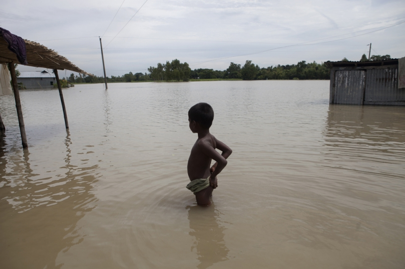 A boy stands in floodwaters, waiting for a boat at Islampur, Jamalpur. According to the Bangladesh Disaster Management Bureau around 1.5 million people have been affected by this year flood. Rivers in the north started to rise in early July and by the 20th of July nearly all of them started to flow over the danger level. It caused floods in 6 districts, namely, Lalmonirhat, Kurigram, Gaibandha, Jamalpur, Sirajganj and Sunamganj initially and inundated crop fields and dwelling areas, washed away standing crops, houses and household's assets, livestock and displaced the affected people.Bangladesh is one of the most climate change-vulnerable and disaster-prone countries. The rivers of this country are facing tremendous environmental anomalies. They overflow during the rainy season but shrink in other seasons. Floods in our country are directly or indirectly related to sub-Himalayan countries like India, Bhutan, and Nepal. An understanding should be made to protect the eco-system in the regions to minimize the risks of flash floods, and to share the water resources as per international laws.