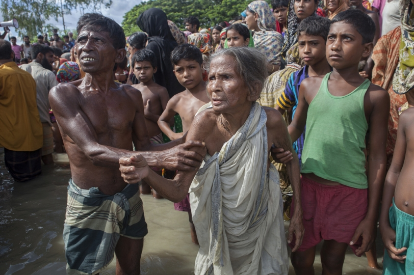 An elderly woman and her son showing fervidity to the local government to get relief at Islampur, in Jamalpur.