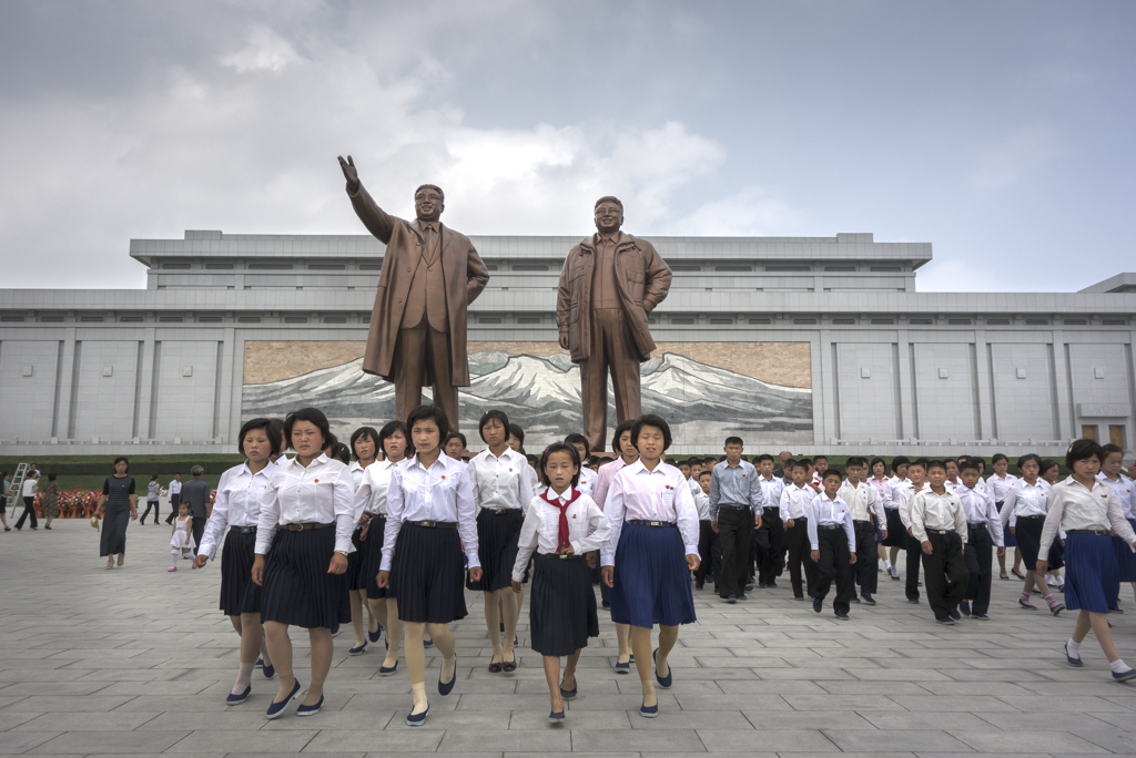 group of North Koreans visit the Grand Kim IL Sung Monument at Mansu Hill