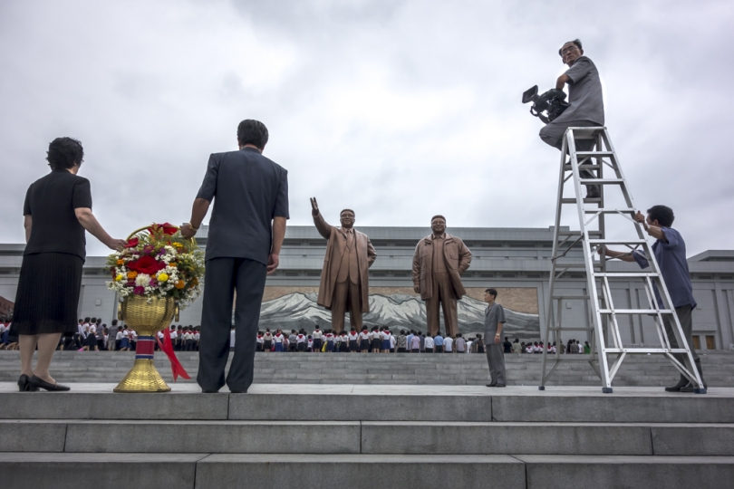 TV crew prepare to document workers visiting the Kim IL Sung Monument