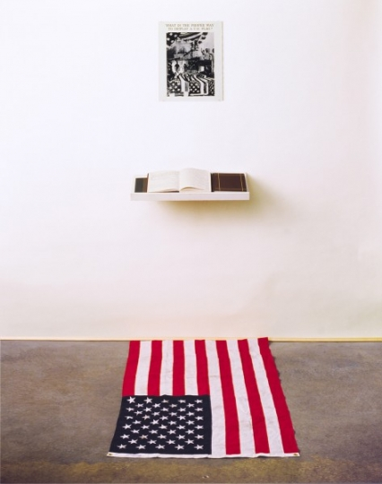 What is the Proper Way to Display a U.S. Flag, 1988; Silver gelatin print, US flag, book, pen, shelf, audience; 80 x 28 x 60 inches © Dread Scott