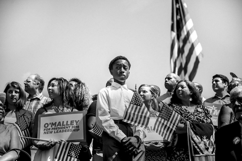 Gabriella Demczuk, A boy stands on stage before the arrival of Martin O'Malley, Baltimore, Md. on May 30, 2015. © Gabriella Demczuk