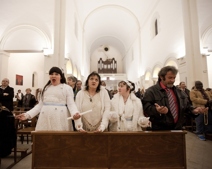 Maddelena, 11 years old, her mother Francoise, her sister Ilona, 12 years old, and her father Thierry, the day of their first communion, during the ceremony at the Saint Cleophas Church in Montpellier ©Sandra Mehl