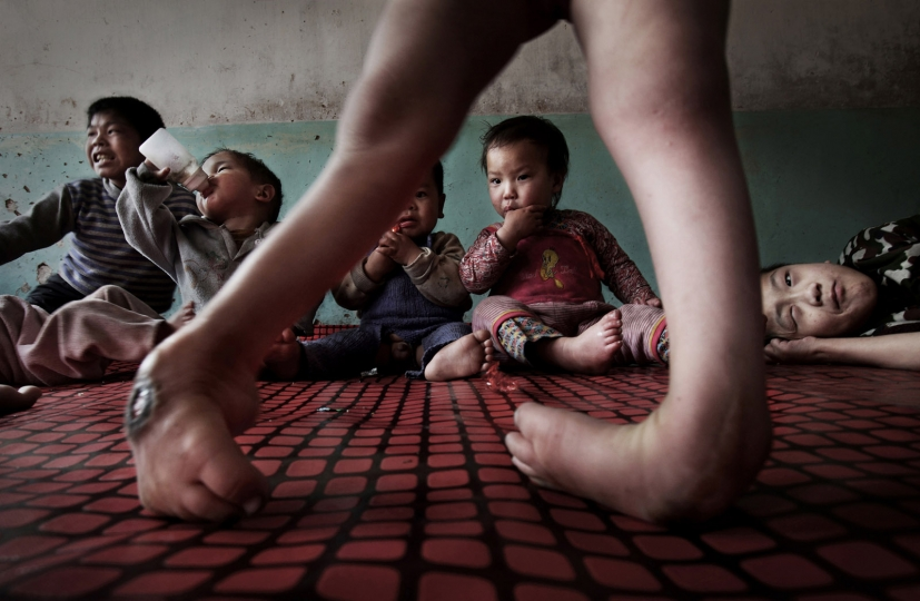 Disabled orphans adopted by charitable farmers Shanxi 2009 © Lu Guang