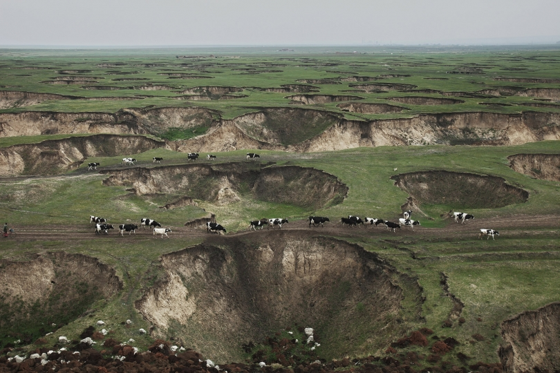 Coal mining left Hulun Buir Grassland pockmarked by sinkholes Inner Mongolia 2012 © Lu Guang