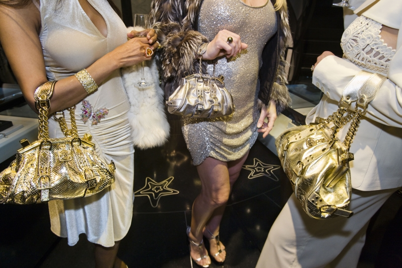 Jackie and friends with Versace handbags at a private opening at the Versace store, Beverly Hills, California, 2007. © Lauren Greenfield