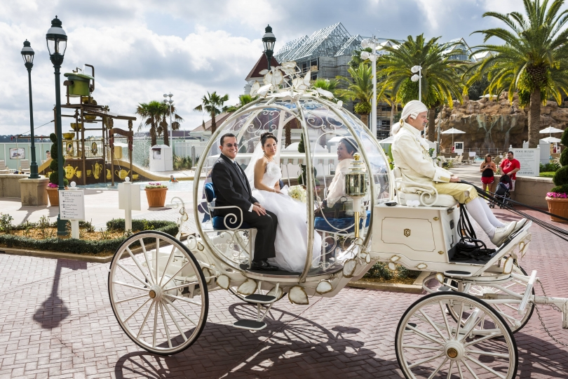 Christina, 21, a Walmart pharmacy technician, en route to her wedding in Cinderella's glass coach, drawn by six miniature white ponies and with bewigged coachman, Walt Disney Wolrd, Orlando, Florida, 2013. © Lauren Greenfield