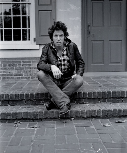 Bruce Springsteen sitting on the steps to the Indian Tavern, Haddonfield, NJ, 1978