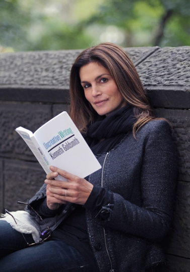 READING...Supermodel Cindy Crawford poses with