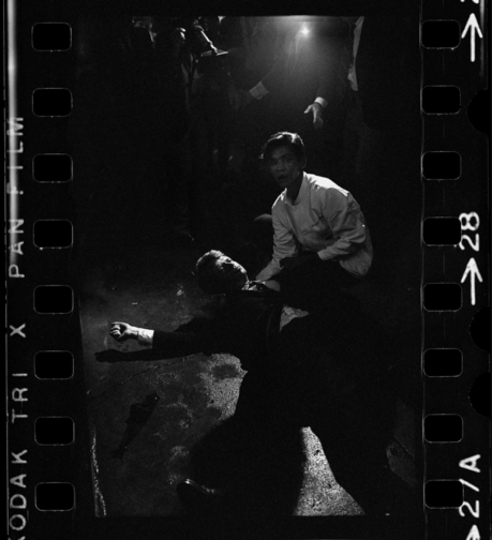 Robert F. Kennedy Shot: Busboy Juan Romero tries to comfort Presidential candidate Bobby Kennedy after assassination attempt, Ambassador Hotel, Los Angeles, California, June 5, 1968. Courtesy Monroe Gallery of Photography © Bill Eppridge