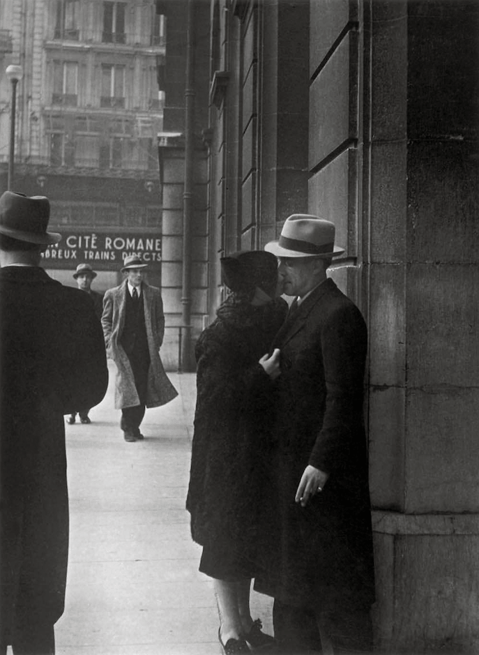 Brassai, Extinguishing a Streetlight, Lovers at the Gare Saint-Lazare, 1937 © Estate Brassai Succession