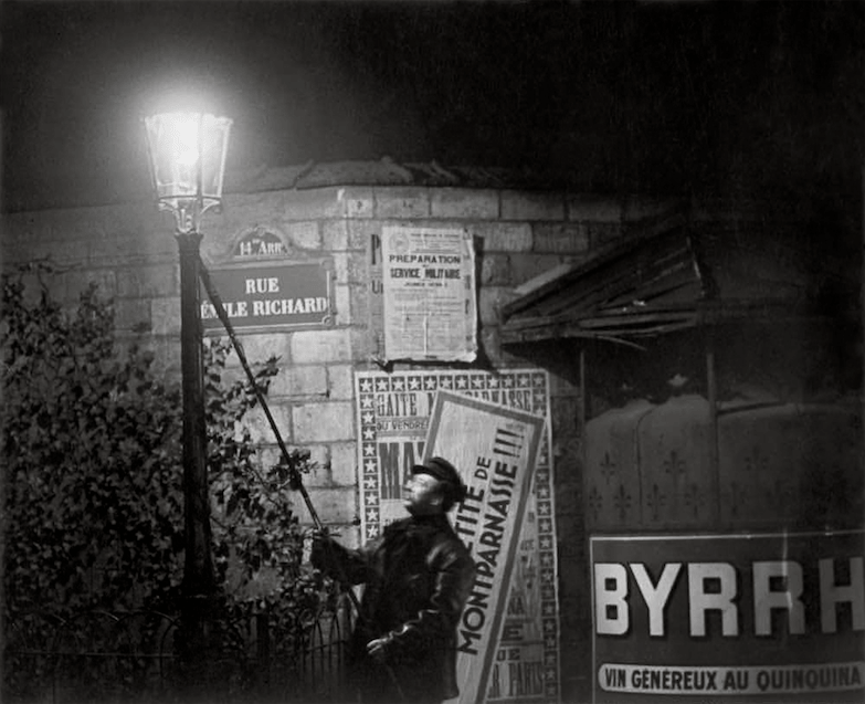 Brassai, Extinguishing a Streetlight, Rue Émile Richard, 1932 © Estate Brassai Succession