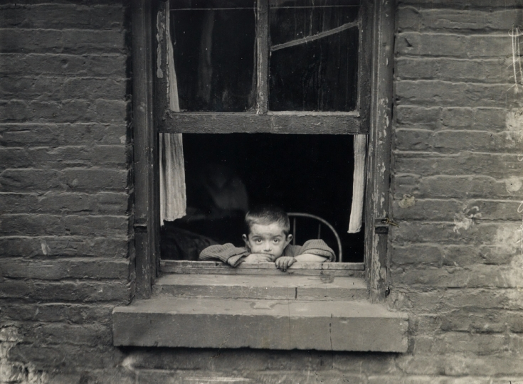 Lot 36. Lewis W. Hine, Child at window. Silver print, Circa 1910; printed circa 1931