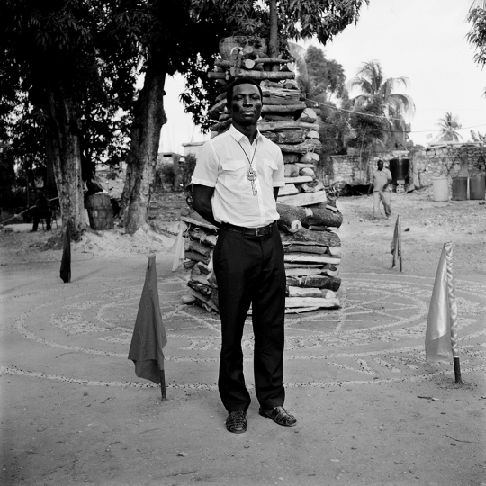 Secretary in front of 'Bwa Sen Jan' (the wood of St John the Baptist) at Parfaite Sincérité des Coeurs Réunis #4 Orient de Jacmel 1795 (2014) © Leah Gordon
