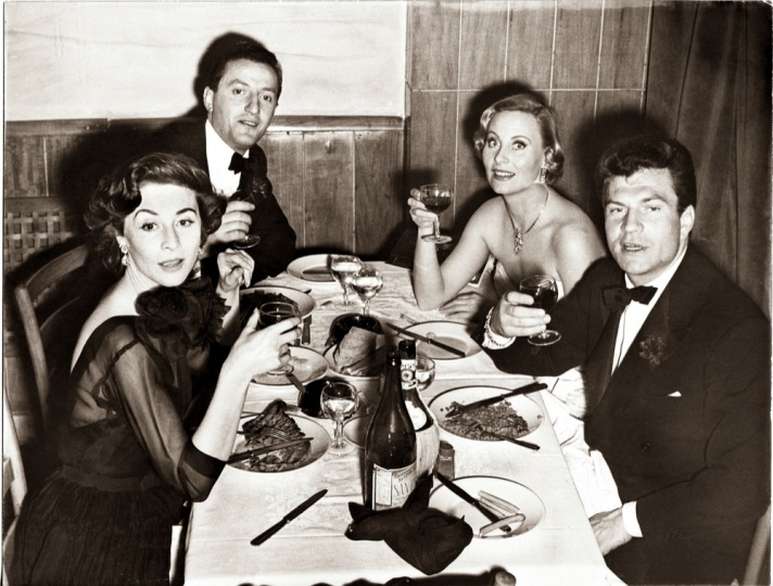 Michele Morgan, her husband Henri Vidal, Gigi de Terwanghe, Benno Graziani. New Year's Eve party at the restaurant Capriccio, Roma, Italy. 31st December 1953.