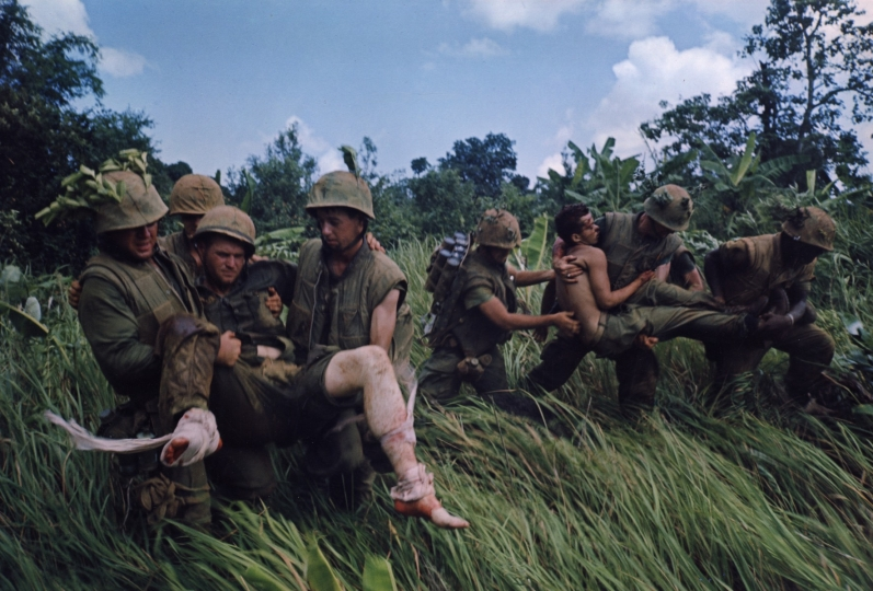 Marines Recover the Body of a Comrade while under Fire, Operation Prairie, 1966 © Courtesy Laurence Miller Gallery and The Larry Burrows Collection