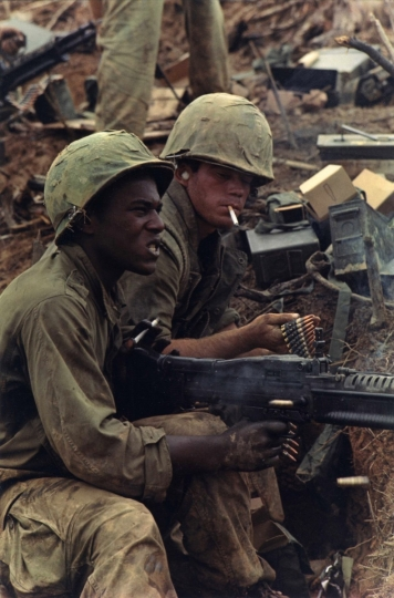Renewed Assault by 3rd Battalion, 4th Marines on the NVA holding Hill 484, 1966 © Courtesy Laurence Miller Gallery and The Larry Burrows Collection