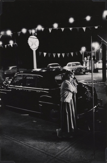 W. Eugene Smith, USA, 1918-1978, Girl leaning on a parking meter, Shadyside Chamber of Commerce carnival, Walnut Street, 1955-1957, gelatin silver print, 33.66 x 22.22 cm, Gift of the Carnegie Library of Pittsburgh, Lorant Collection ©W. Eugene Smith / Magnum Photos