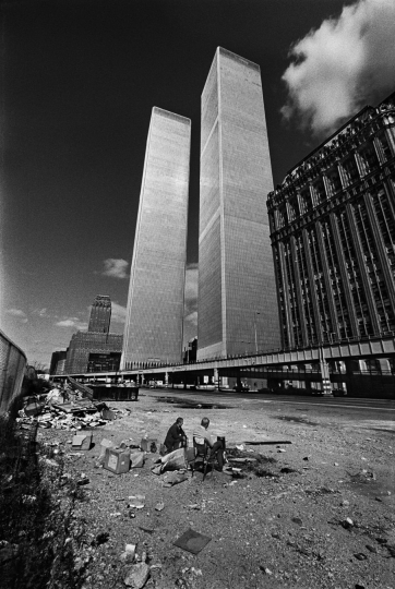Manhattan, New York City, NY. October, 1975. Two homeless men squat below the recently constructed World Trade Center. New York was bankrupt, in shambles and the building was not occupied. © Jean-Pierre Laffont