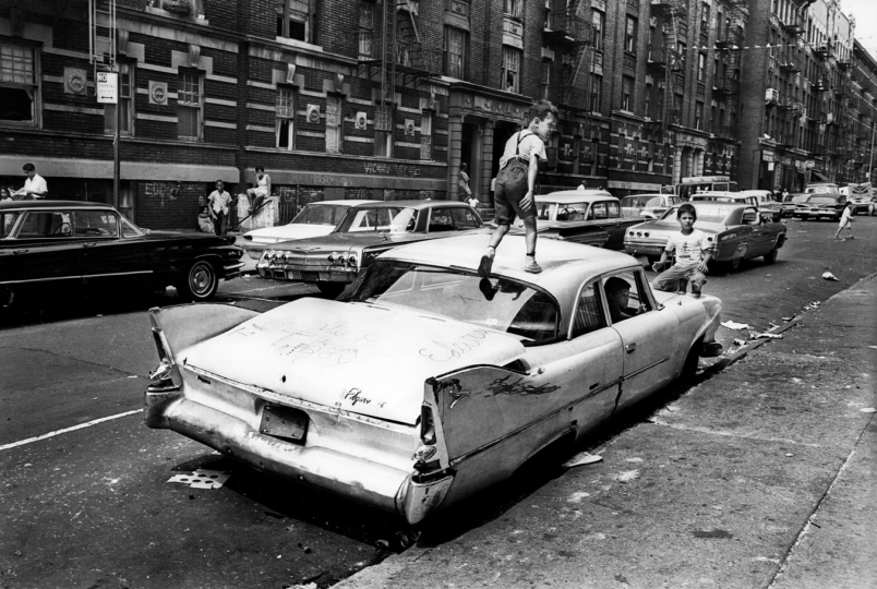 Bronx, New York City, NY. Summer of 1966. An abandoned car becomes a place for kids to play in Fox Street. From the mid-1960s to the late-1970s, quality of life for Bronx residents declined sharply. © Jean-Pierre Laffont