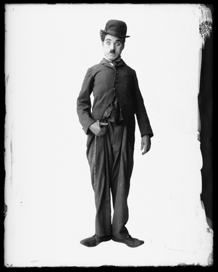 Charles Chaplin poses as the Tramp (Essanay period) circa 1915. From the Archives of the Roy Export Co. Ltd / courtesy Musée de l'Elysée, Lausanne
