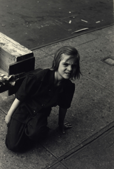 Girl kneels on the sidewalk, New York City, ca. 1945 © Sandra Weiner