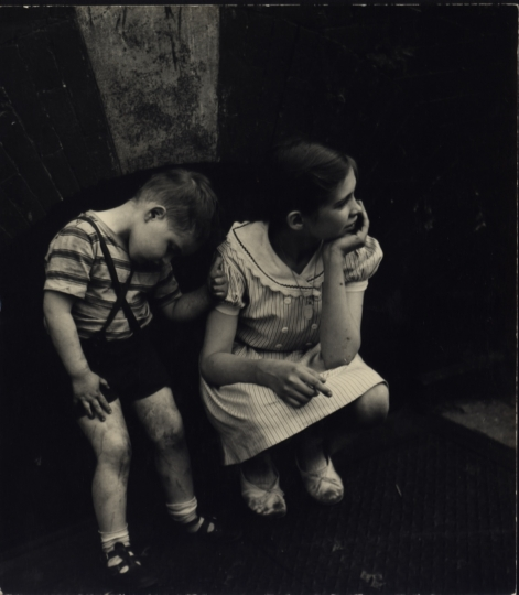 Children crouching over a closed basement door, New York City, ca. 1945 © Sandra Weiner