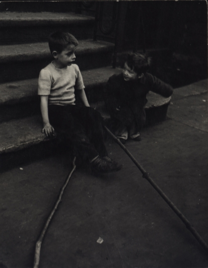 Mickey with sticks sitting on steps, New York City, ca. 1948 © Sandra Weiner
