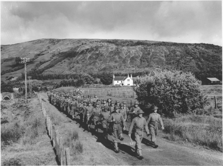 Beginning with a 30 mile jaunt at a rapid stride, a company of Rangers step briskly during a speed march through the picturesque Scottish countryside. Five miles an hour was a daily grind for these stalwarts who claimed the speed march as a secret weapon. © Phil Stern Archives