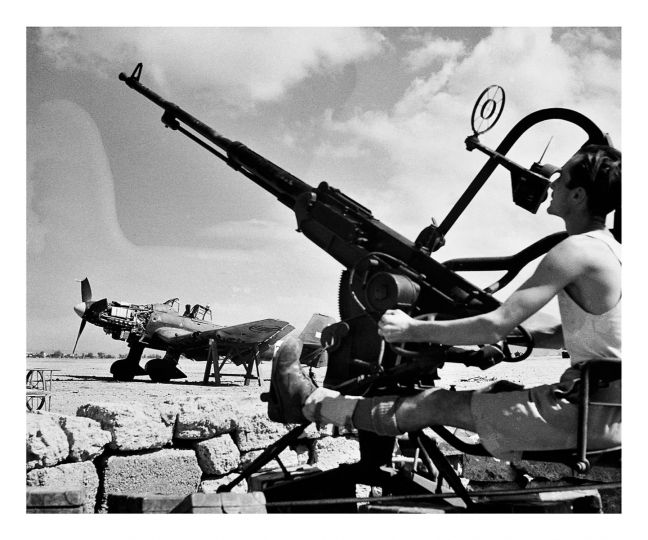 A Ranger mans an antiaircraft gun at Palermo Airport. Having captured the ports of Agrigento and Porto Empedocle days earlier. Patton's Seventh Army entered the lightly defended northern capital on July 22, 1943. With the British moving towards Messina from the south, the Italians and Germans realized Sicily could no longer be defended and hastened a retreat from the Island. © Phil Stern Archives