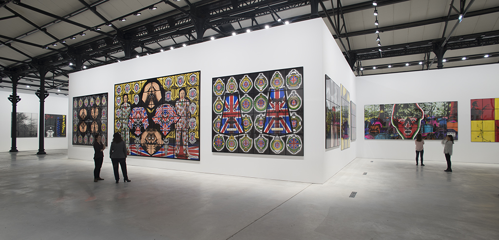 Gilbert & George: THE GREAT EXHIBITION (1971- 2016). Vues d'exposition, la Mécanique Générale, Luma Arles, Parc des Ateliers, Arles, France, 2018. © Lionel Roux. Gilbert & George: THE GREAT EXHIBITION (1971- 2016). Exhibition view, la Mécanique Générale, Luma Arles, Parc des Ateliers, Arles, France, 2018. © Lionel Roux.