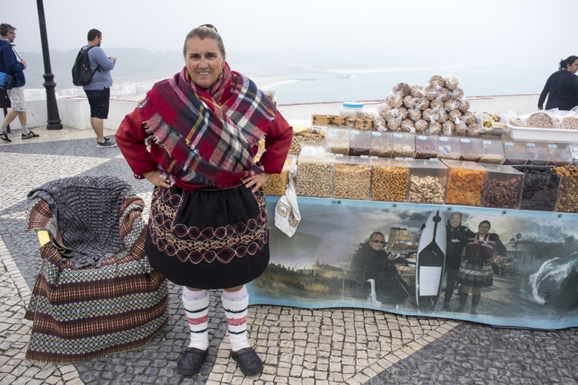 May 8, 2018, Nazare, Portugal: Nazare has transitioned from a fishing village to a popular beach resort. Even a cloudy, foggy day the town and beaches look beautiful. The Sitio neighborhood has amaxing views and sights. Vendors in traditional dress. © ALLAN TANNENBAUM