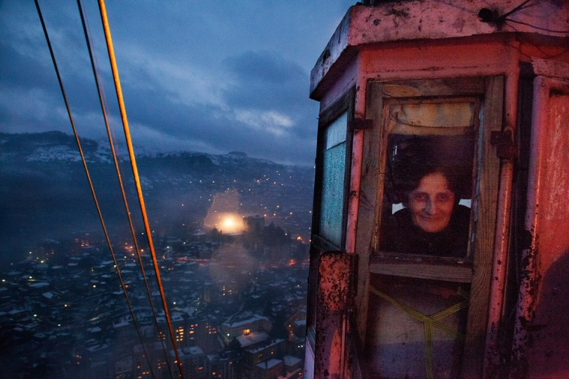 "Tschiatura. From the series ""Black Gold"", 2014–2015 © Daro Sulakauri A conductress of the funicular on night turn. The funiculars in the mining town Chiatura were built during the Soviet Era 60 year ago to carry the miners to work. Today they are used for public transport."