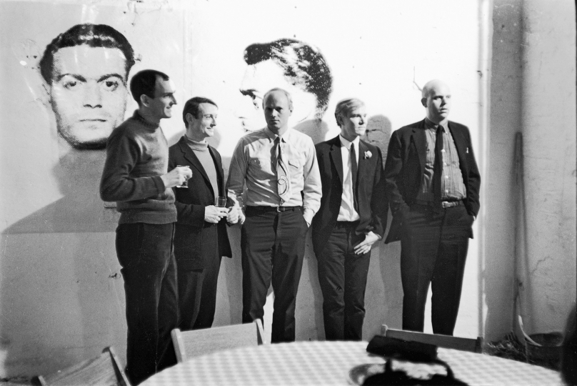 Pop artists Tom Wesselmann, Roy Lichtenstein, James Rosenquist, Andy Warhol, and Claes Oldenburg at Warhol's Factory, 231 East Forty‑Seventh Street (its first location, until 1967), April 21, 1964 Vintage gelatin silver print, printed ca. 1964 11h x 14w in Titled, dated, and stamped by photographer verso - Copyright Fred W. McDarrah, Courtesy Steven Kasher Gallery, New York