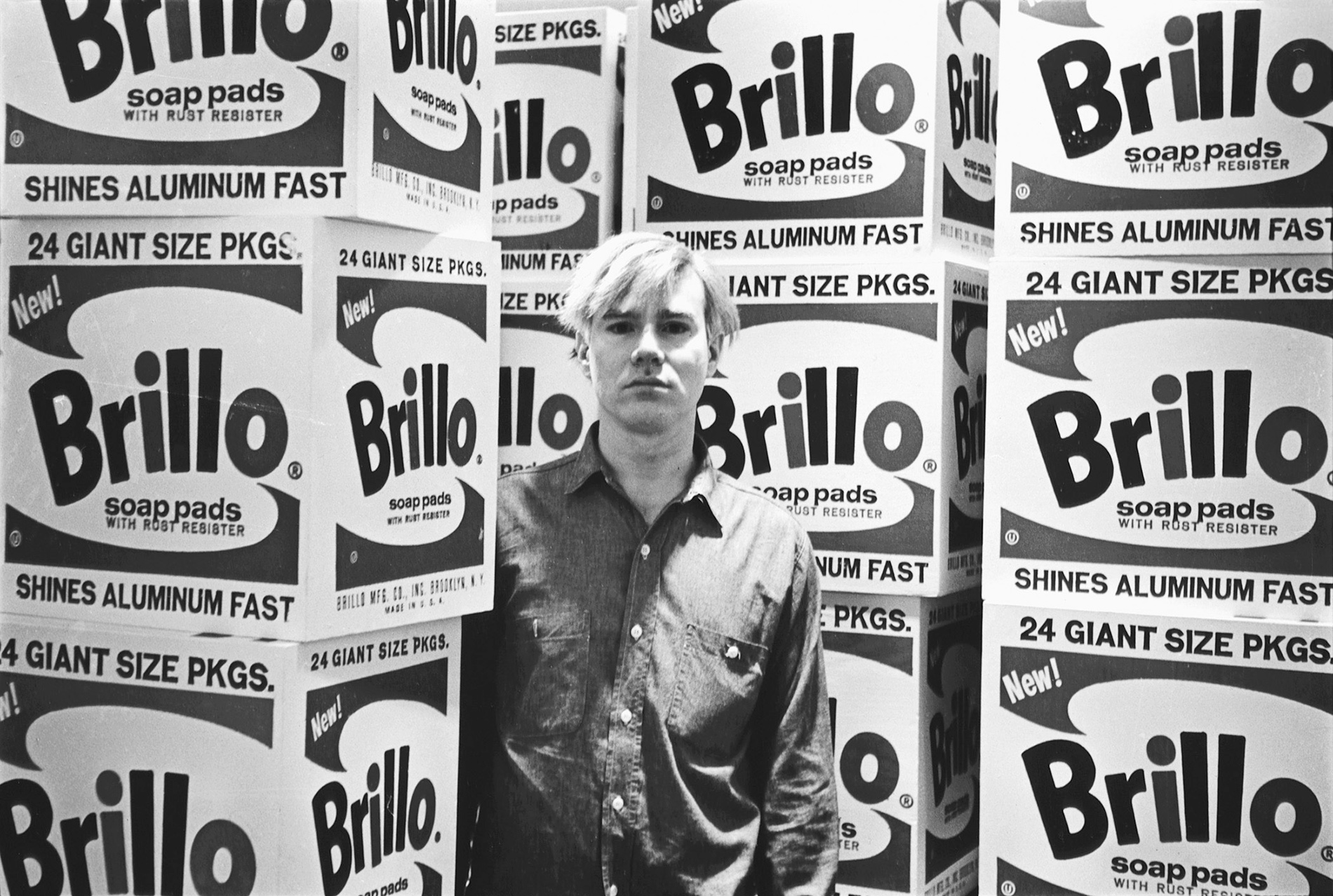 "Andy Warhol at the opening of his exhibition, ""The Personality of the Artist,"" at the Stable Gallery, 33 East 74th St., April 21, 1964 Vintage gelatin silver print, printed ca. 1964 Copyright Fred W. McDarrah, Courtesy Steven Kasher Gallery, New York"